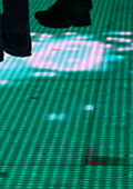 the Wishing Well floor is a matrix of variable-coloured light cells