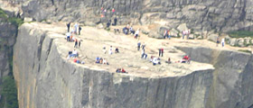 people enjoying the views from Pulpit Rock - seen from a sightseeing helicopter