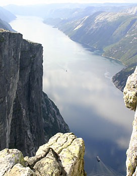 looking down Lysefjorden from Kjerag towards Pulpit Rock - the little boat below is a ferry for 50 cars