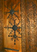 ornate carved door frame and iron door decoration