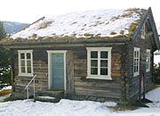 an old log cottage on the site