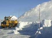 snow-blowers try to keep the road open